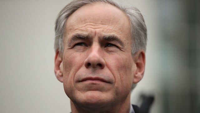 Texas governor vetos bill banning guns in parts of an airport tarmac